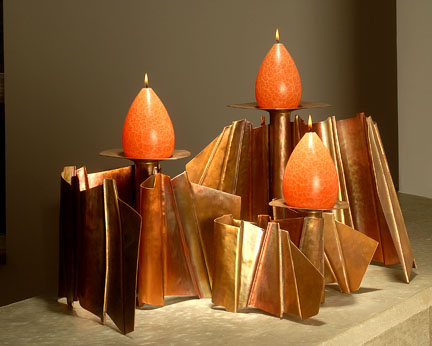 Tom MArkusan folded copper candle holders with Barrick Candles.